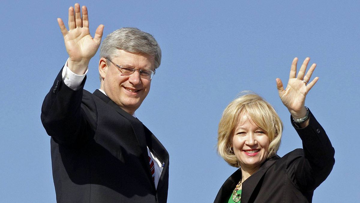 Stephen Harper and his wife Laureen prepare to depart the Ottawa airport for Colombia, where the Prime Minister will attend the Summit of the Americas, on April 13, 2012.