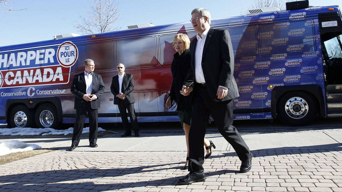 Conservative Leader Stephen Harper walks with his wife Laureen during a campaign stop in Brampton, Ont.