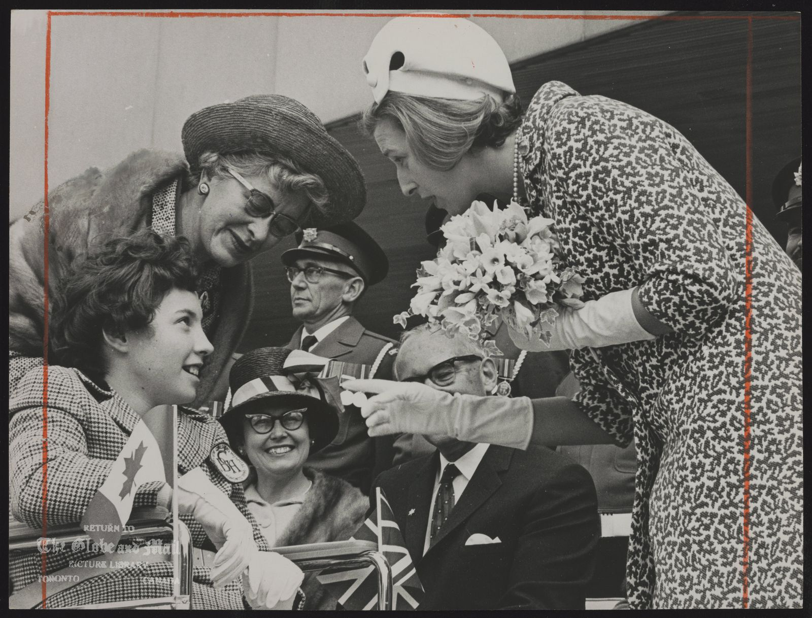 ROYAL FAMILY Gt. Britain. Princess Alexandra. (Visit to Canada May 1967) Princess Alexandra chats with Robin Hadley, 13, after the patients at Bloorview Children's Hospital presented her with a bouquet outside [Toronto] City Hall. Standing by is hospital administrator Mrs. Edith G. White. More than 3,000 children were present to greet the children? [royal visitor].