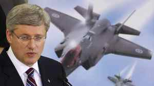 Prime Minister Stephen Harper speaks to employees at Virtek Vision International Inc. in Waterloo Ontario March 11, 2011. They manufacture materials used in the F35 fighter jet, the procurement process for which has stirred up much public controversy.