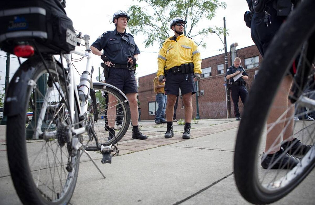 Sgt. James Hogan and Police Constable Tony Correa survey the scene of an accident they came across during their regular bike patrol of 12 Division.