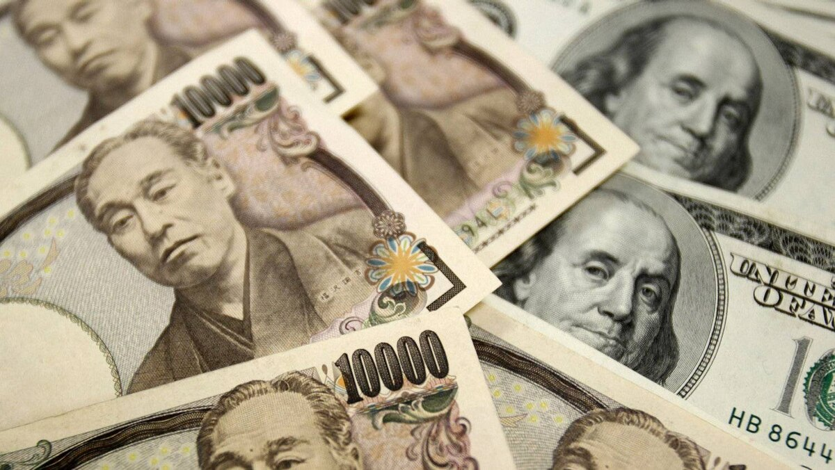 Japanese 10,000 yen notes (L) and U.S. $100 dollar notes are seen in this picture illustration.