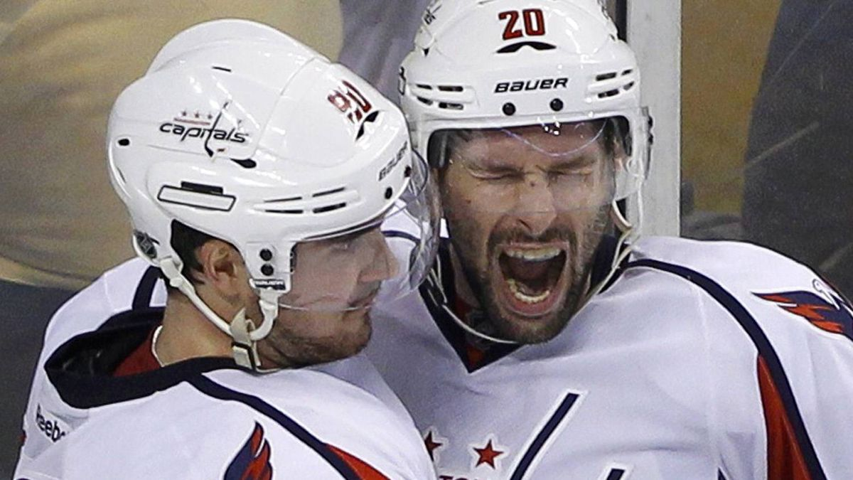 Washington Capitals' Troy Brouwer (R) celebrates with teammate Marcus Johansson after scoring on the Boston Bruins during the third period in Game 5 of their NHL Eastern Conference quarter-final hockey playoff series in Boston, Massachusetts April 21, 2012. The Capitals won 4-3 to take a 3-2 series lead. REUTERS/Brian Snyder