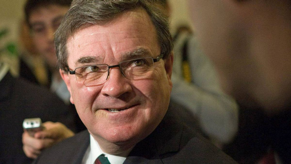 Federal Finance Minister Jim Flaherty speaks to reporters before meeting with his provincial and territorial counterparts in Victoria on Dec. 19, 2011.