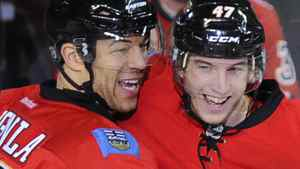 Calgary Flames' Jarome Iginla (L) and teammate Sven Baertschi celebrate Baertschi's goal during the second period of their NHL hockey game against the San Jose Sharks in Calgary, Alberta March 13, 2012. REUTERS/Todd Korol