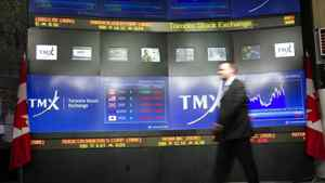 TMX Broadcast Centre manager Kris Backus walks in front of the centre's display board in Toronto.