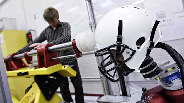 Evan Walsh helps set up the linear impactor to simulate a football collision. Research assistants in the neurotrauma impact science lab at the University of Ottawa are developing new 3-D impact protocol for evaluating helmet safety in Ottawa, Sept. 19, 2011.