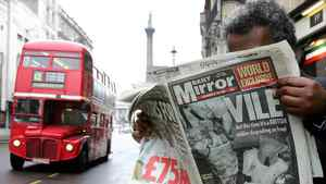 A man in London reads the Daily Mirror newspaper of May 1, 2004 featuring photographs it said were of British soldiers abusing an Iraqi prisoner. The photos were later proved to be a hoax.