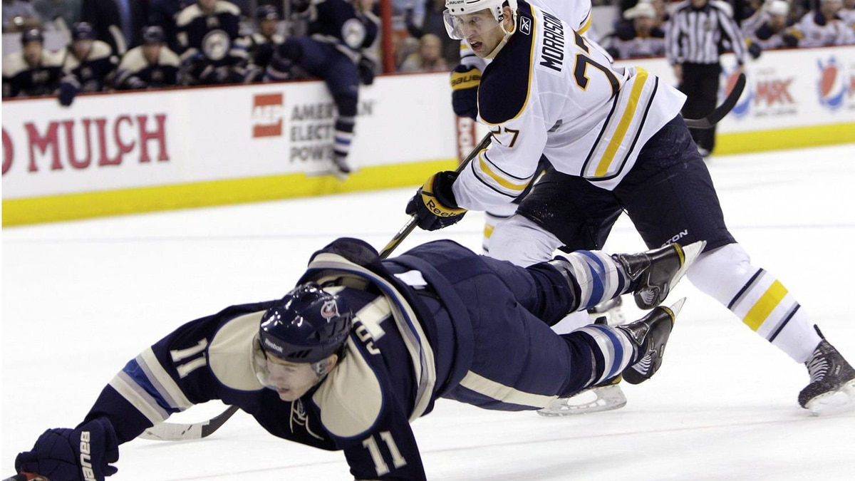 Buffalo Sabres' Shaone Morrisonn, right, hooks Columbus Blue Jackets' Matt Calvert, knocking him to the ice during the second period of an NHL hockey game Saturday, April 9, 2011, in Columbus, Ohio. The Sabres won 5-4. (AP Photo/Jay LaPrete)