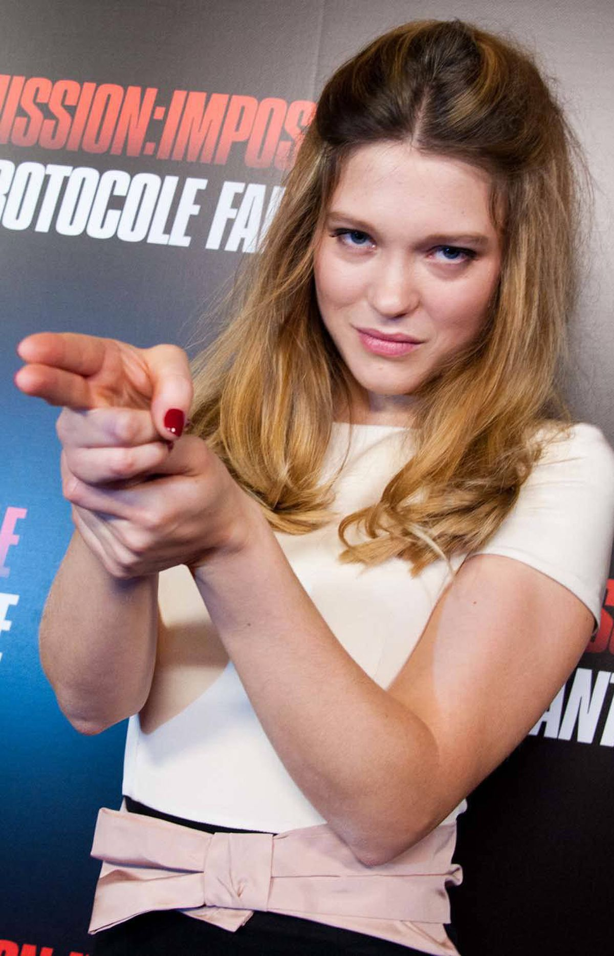 "Actress Lea Seydoux beats herself in a solo game of Rock Scissors Paper at the premiere of Mission: Impossible - Ghost Protocol"" in Ivry-sur-Seine, France, on Sunday."