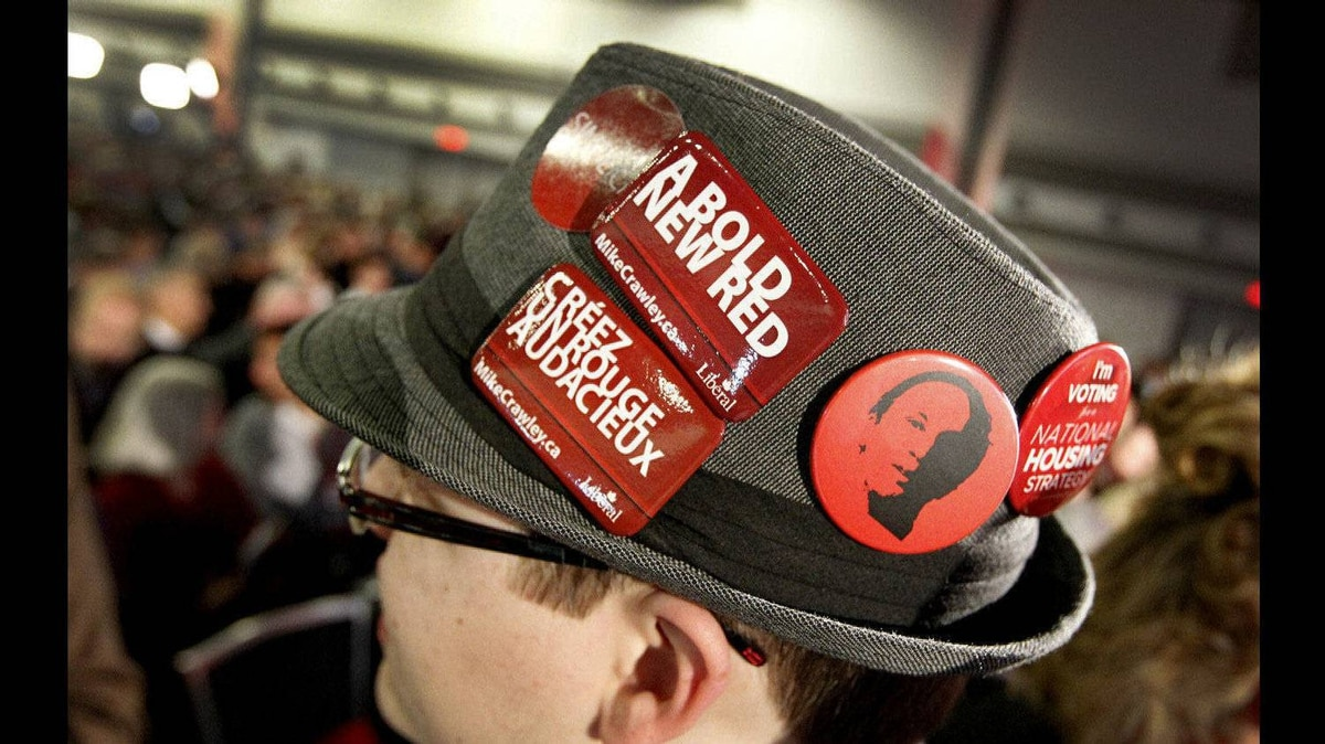Derrick Murphy, 19, right, from Vancouver B.C. wears buttons showing his support for Liberal candidates as well as his idol, former Liberal prime Minister Pierre Trudeau.