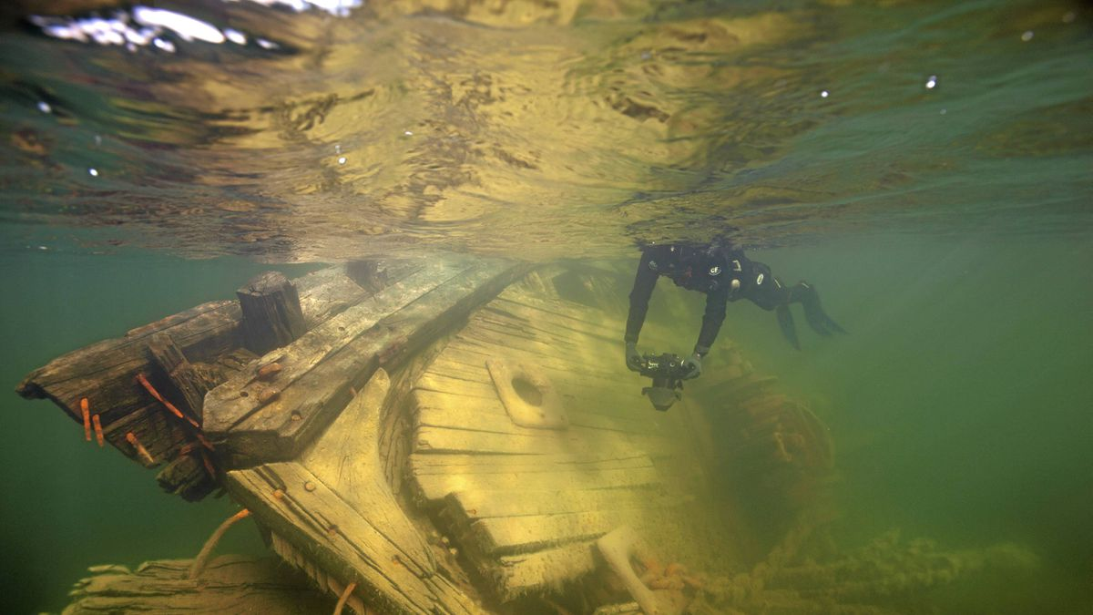 Project Manager Jan Wanggaard surveys the wreck of the Maud in Cambridge Bay Aug. 6, 2011.