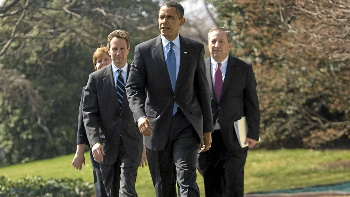 President Obama leads his economic team to the South Lawn of the White House in Washington, Wednesday, March 18, 2009, to make a statement on AIG. From left are, Council of Economic Advisers Director Christina Romer, Treasury Secretary Timothy Geithner, the president, and Director of the National Economic Council Lawrence Summers.