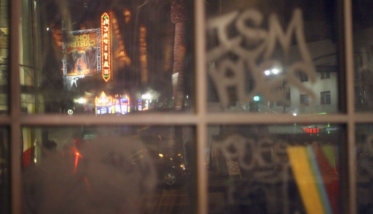 The El Capitan Theatre, across the street from the site of the 84th Academy Awards, is reflected in graffiti-covered windows in Hollywood, California early February 21, 2012.