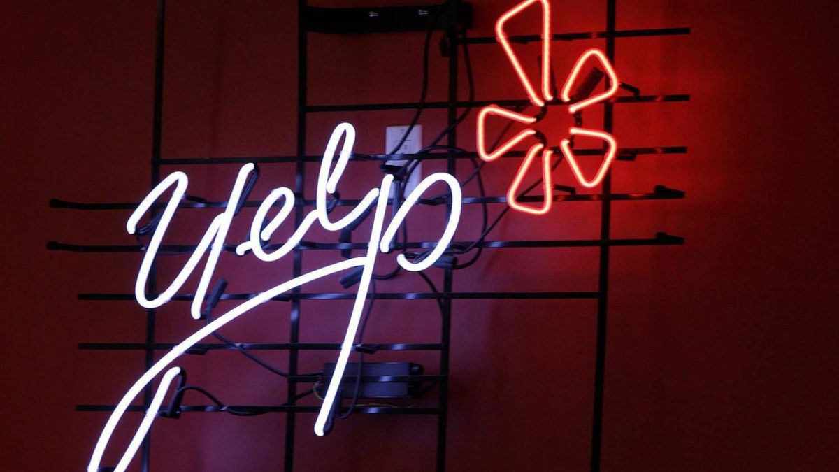 Yelp's logo is seen in neon on a wall at the company's Manhattan offices in New York.