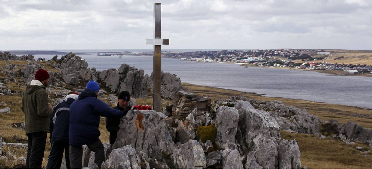 Argentine Falklands War veterans stand next to a memorial site for British soldiers who died during the conflict on Wireless Ridge, near Port Stanley March 12, 2012.