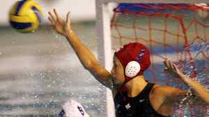 Goalkeeper Rachel Riddell of Canada tries to stop a shot by Brazil during a Pan American games women's water polo semi-final game in Rio de Janeiro, Thursday July 19, 2007.