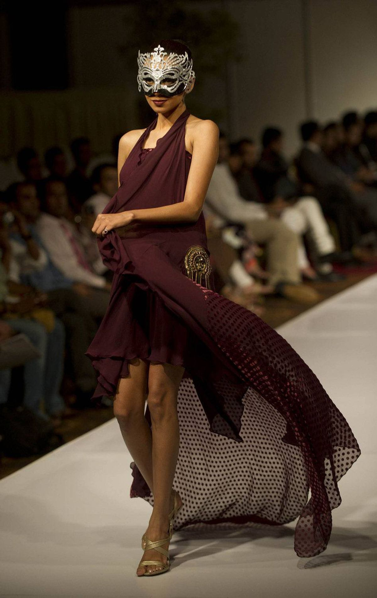 A model presents a creation by Pakistani designer Aamir Baig on the first day of the fashion week in Karachi on October 6, 2011.