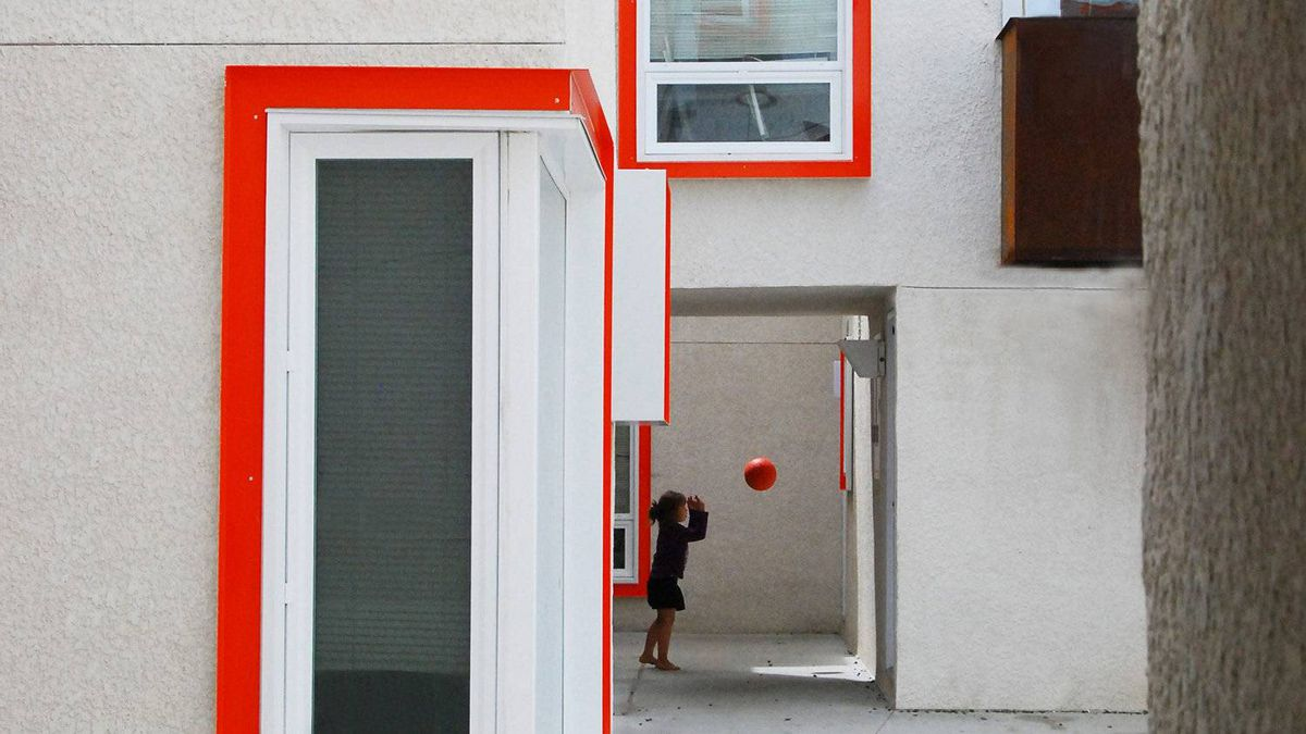 A girl plays ball in the courtyard at Centre Village.