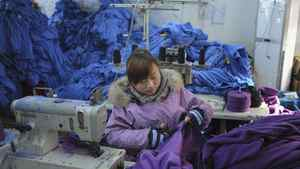 An employee works at a garment factory in Wuhu, Anhui province.