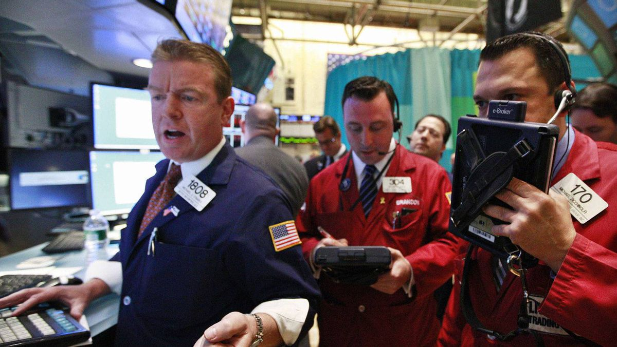 Traders work on the floor of the New York Stock Exchange, May 14, 2012.