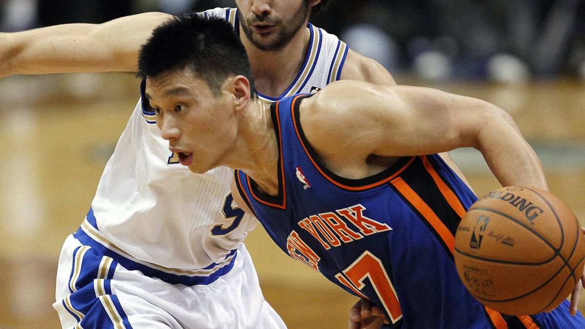 New York Knicks guard Jeremy Lin drives past MInnesota Timberwolves guard Ricky Rubio during the first half in Minneapolis, Feb. 11, 2012.