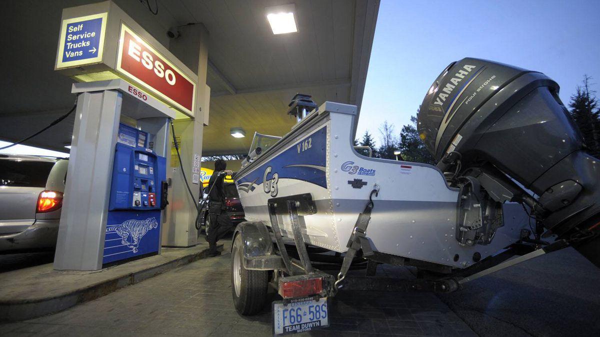 A motorist fills up at a Toronto gas station.