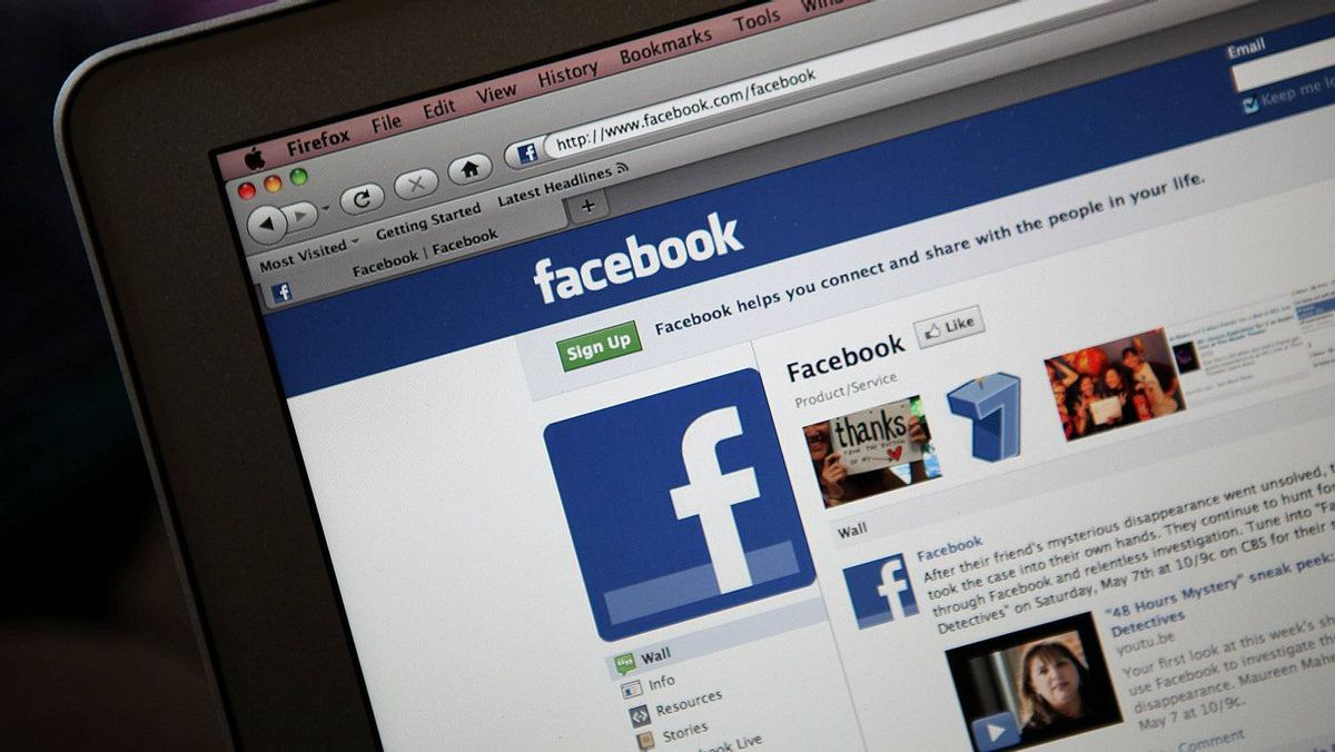 The Facebook website is displayed on a laptop computer
