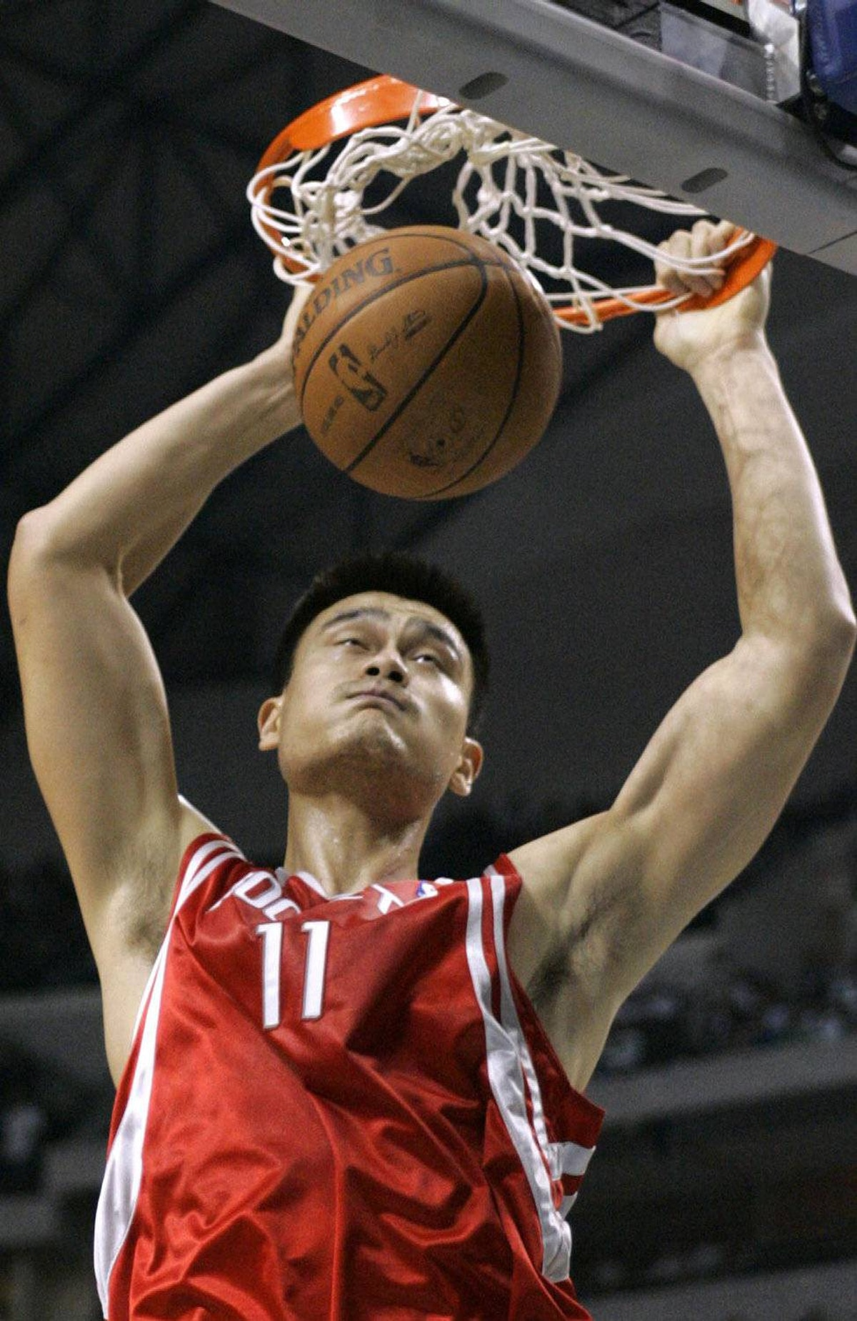 Houston Rockets center Yao Ming, from China, scores against the Dallas Mavericks in the first half of their NBA basketball game in Dallas, Thursday, Oct. 30, 2008.