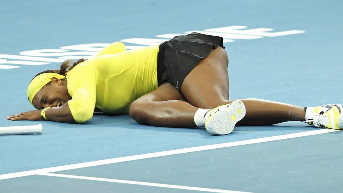 Serena Williams of the United States collapses after twisting her left ankle in her match against Bojana Jovanovski of Serbia.