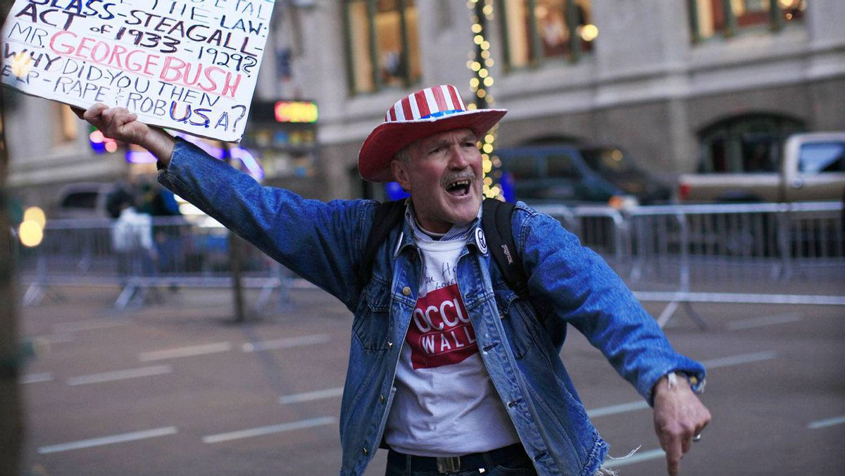 An Occupy Wall Street protester. The growing income and wealth gap has been a mainstay of the protest movement, and the OECD says trickle down economics is dead.