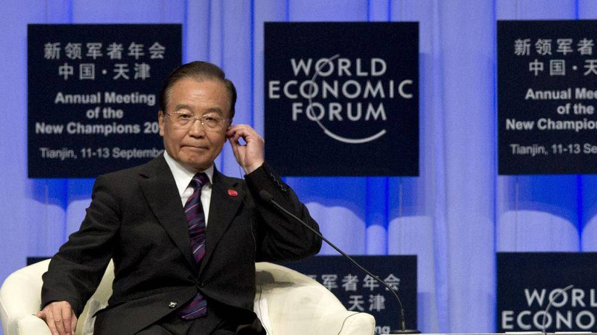 Chinese Premier Wen Jiabao adjusts his earphone upon arriving for the opening of the World Economic Forum's 'Annual Meeting of the New Champions' in Tianjin, China, Tuesday, Sept. 11, 2012. Associated Press