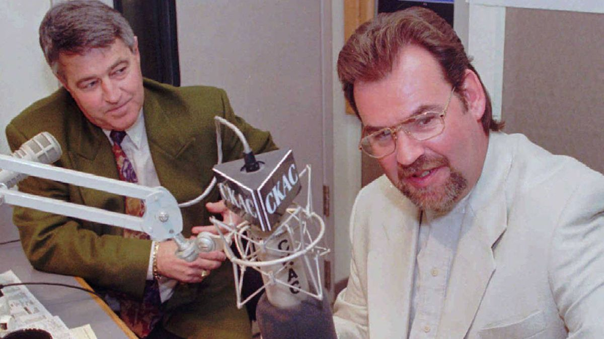 Former Toronto Maple Leafs coach Pat Burns (R) and former Quebec Nordiques coach Michel Bergeron man the mikes during a sports radio show in Montreal Monday. Burns, who was fired earlier this year, will be a regular on the show as well as doing color for The Sports Network during the hockey playoffs.(CP PHOTO)