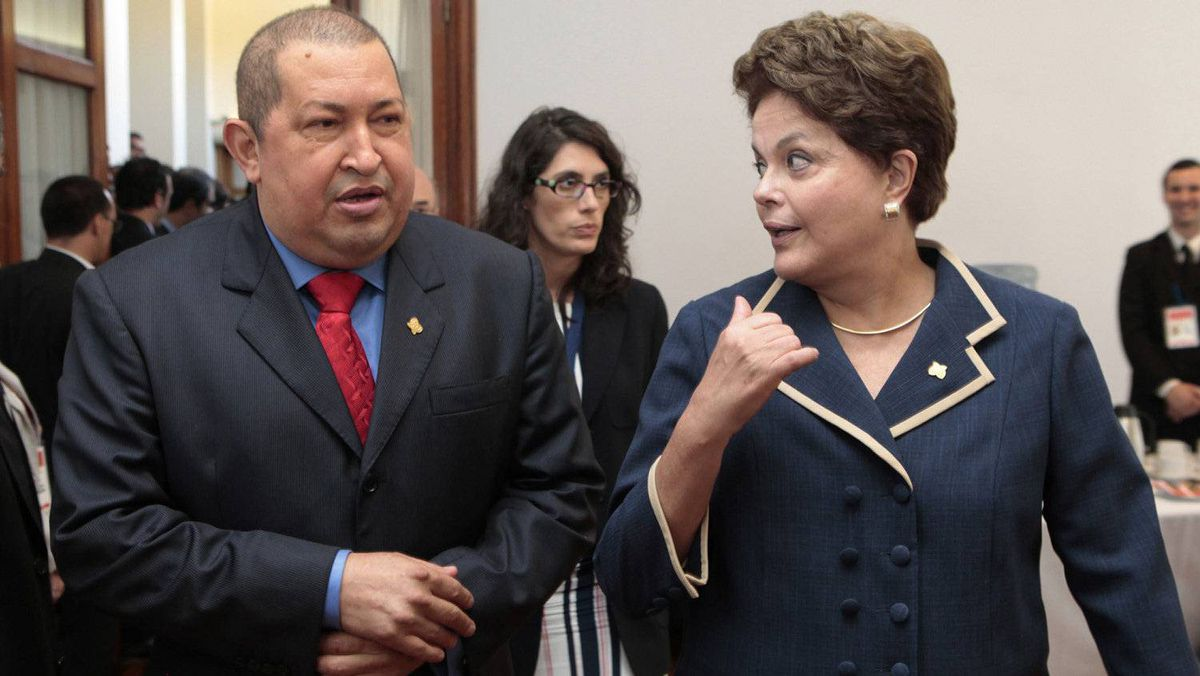 Venezuela's President Hugo Chavez and Brazil's President Dilma Rousseff chat during the Mercosur trade block summit in Montevideo, Uruguay, Dec. 20, 2011.