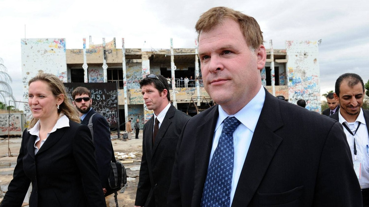 Canada's Minister of Foreign Affairs John Baird, right, and Canadian Ambassador to Libya Sandra McCardell, left, visit the former fortified compound of Moammar Gadhafi in Bab al-Azizya in Tripoli, Libya on Tuesday, October 11, 2011.