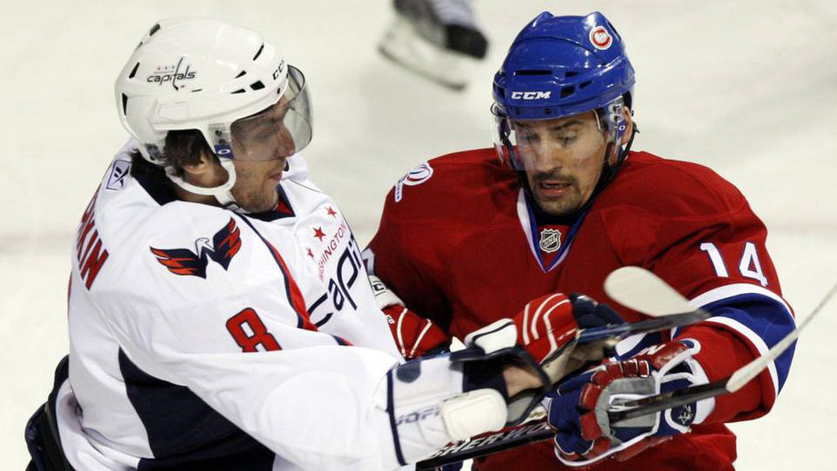 Washington Capitals Alex Ovechkin, left, checks Montreal Canadiens Tomas Plekanec during first period Game 3 NHL Eastern Conference quarter-finals hockey action Monday, April 19, 2010 in Montreal.