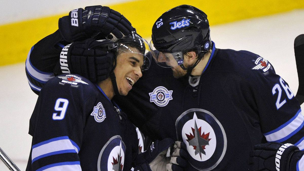 Winnipeg Jets' Blake Wheeler (R) celebrates his goal against the Florida Panthers with Evander Kane (9) during the third period of their NHL hockey game in Winnipeg March 1, 2012.