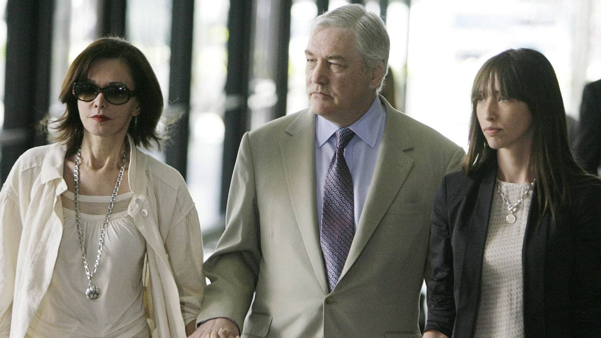 Conrad Black leaves the federal building in Chicago on July 13, 2007, with his wife Barbara Amiel Black and daughter Alana Black after jurors returned a mixed verdict in his fraud and racketeering trial.
