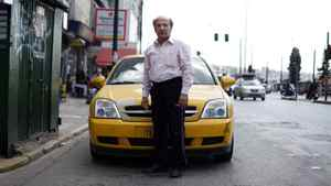 Dasalakis Theodoros, 60, says he and his son share a taxi so they can work 24 hours a day to make ends meet.