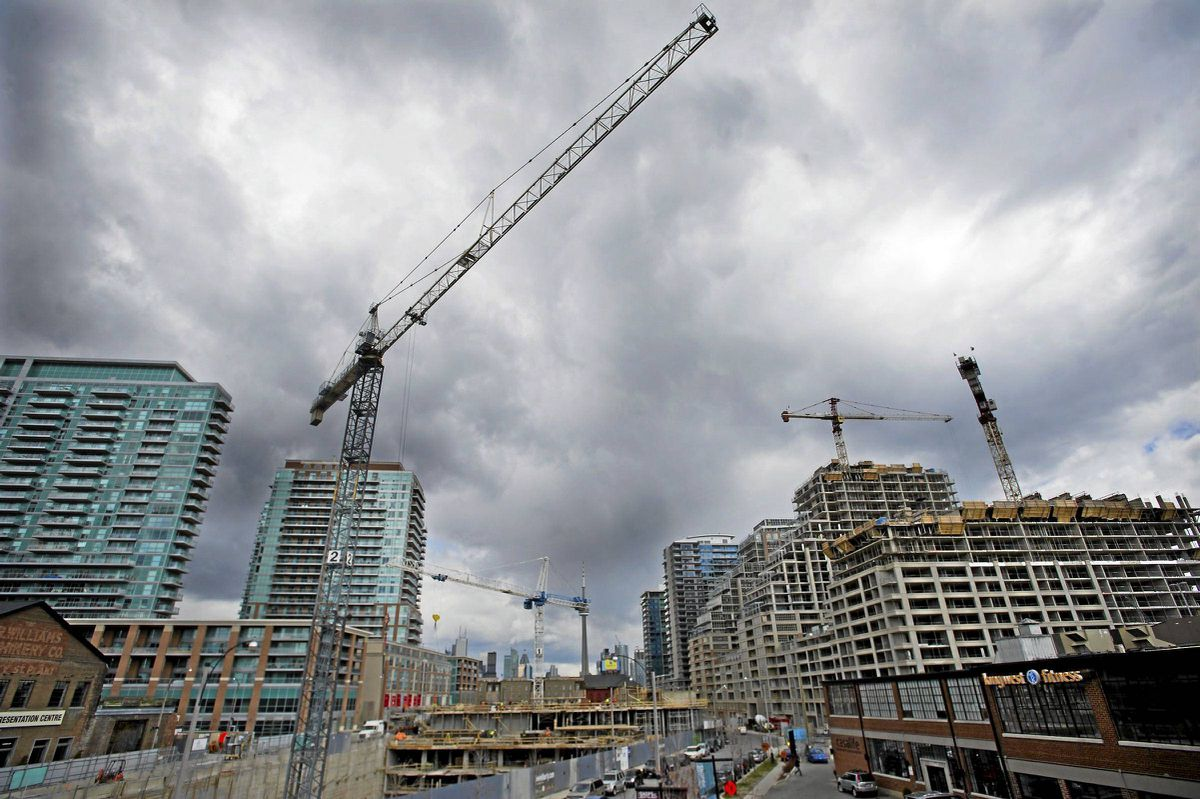 Workers are seen at a condo development in the Liberty Villiage area of Toronto.