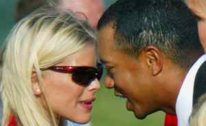 Tiger Woods shares a moment with Elin Nordegren during the opening ceremony for the 35th Ryder Cup matches in Bloomfield, Michigan, on Sept. 16, 2004. The couple married in Barbados on October 4, 2004.