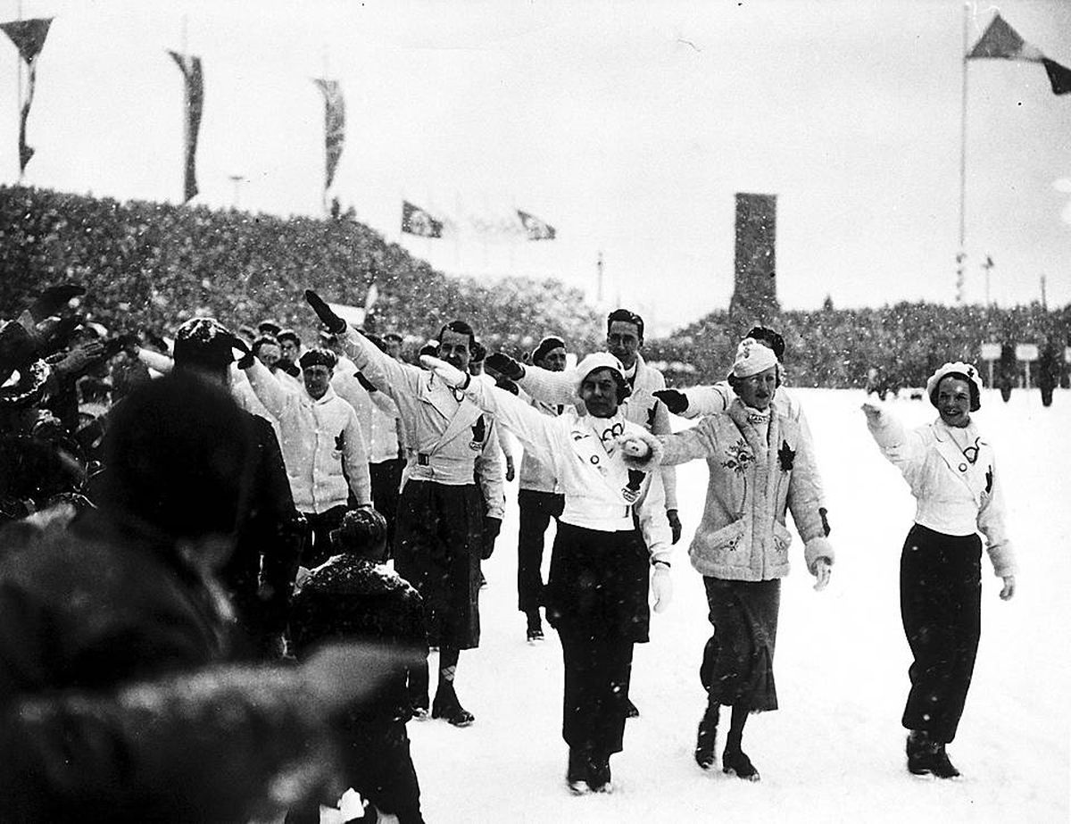 The Canadian ski team at the 1936 Winter Games opening ceremony offered the  Olympic salute,