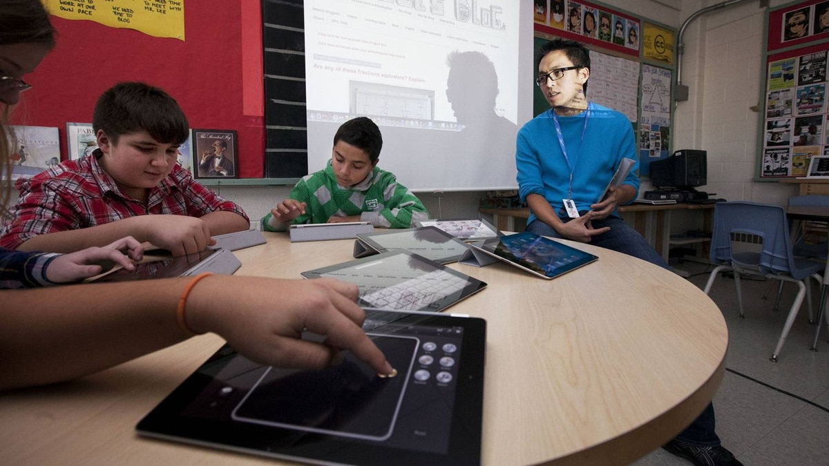 Royan Lee, a teacher at Beverley Acres Public School uses technology to create a more interactive, collaborative and social classroom. It would be difficult, if not impossible, for these students to use iPads if the Ontario English Catholic Teacher's Association got its way and all computers in all new schools were hardwired instead of set up on wireless networks.