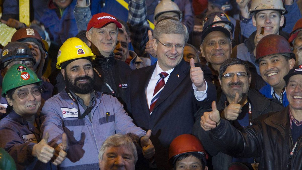 Prime Minister Stephen Harper with workers at the Seaspan shipyards in North Vancouver.