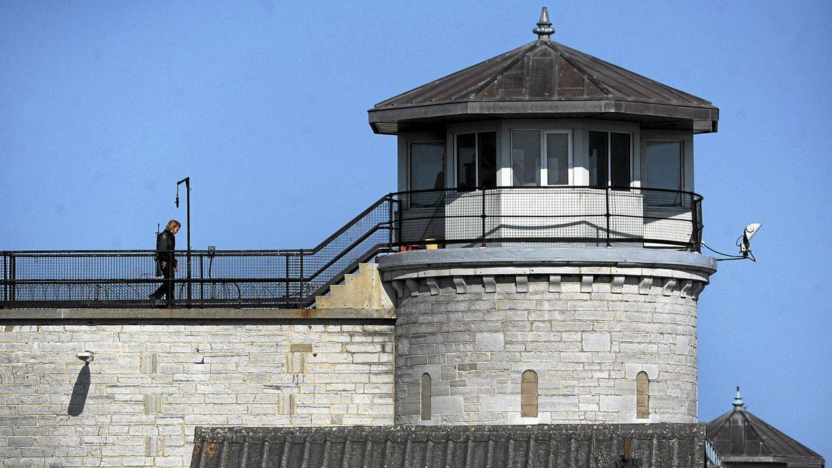 A guard walks along a catwalk at Kingston Penitentiary in Kingston,Ont. Thursday, April 19/2012. The government announced today that they will close the maximum security facility which is home to some of Canada's most notorious criminals.