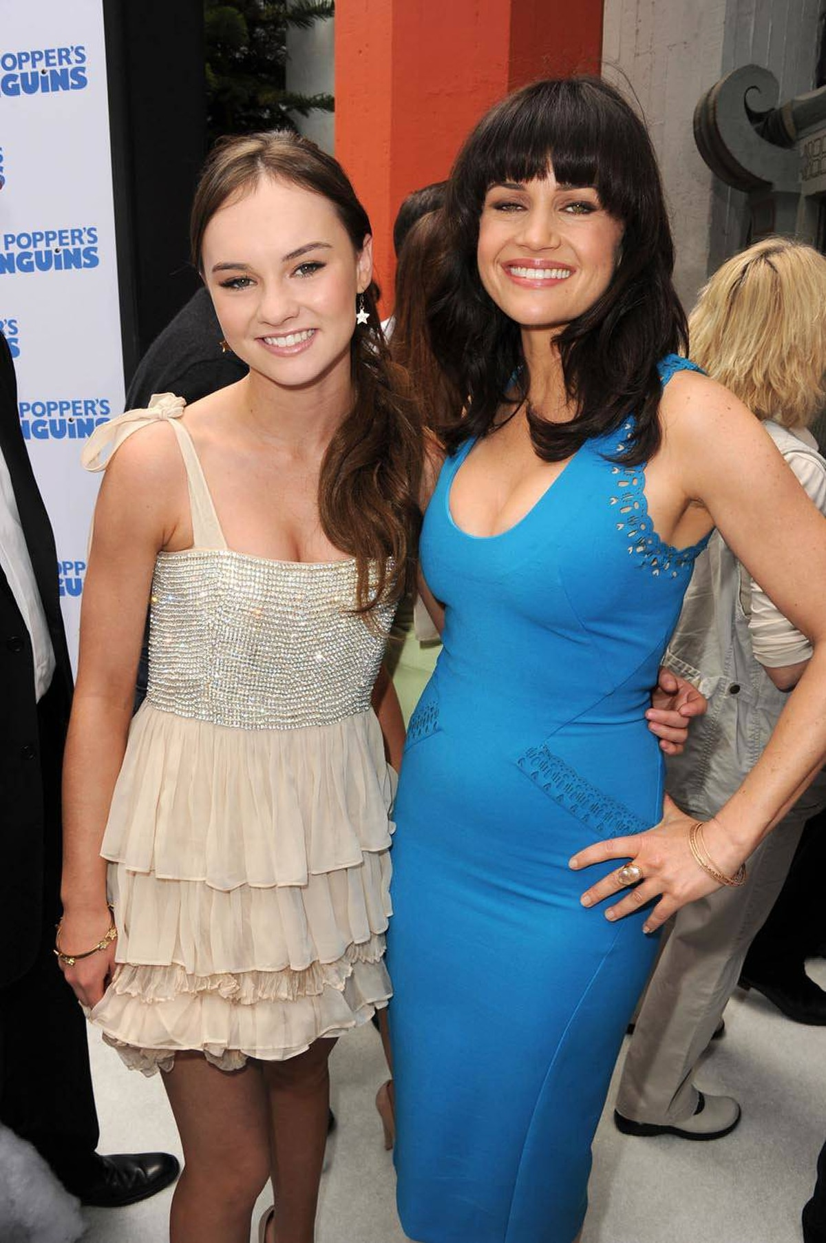 Actresses Madeline Carroll, left, and Carla Gugino arrive at the premiere of Mr. Popper's Penguins on June 12, 2011 in Hollywood.