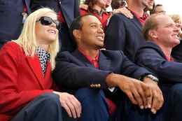 Tiger Woods and his wife Elin Nordegren at the winner's award ceremony at the Presidents Cup golf compeititon in this Oct. 11, 2009 file photo at Harding Park Golf course in San Francisco, California.