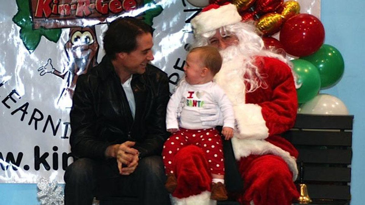 Katherine Scarrow writes: My brother Stephen Scarrow and his 10-month-old daughter Nora at his company's Christmas party. Despite what her T-shirt may lead you to believe, she's not feeling the love for dear old Santa Clause this particular afternoon.