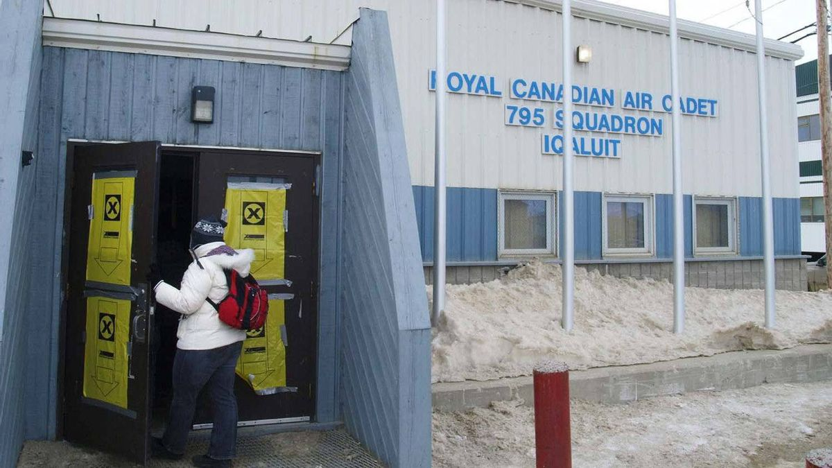 A voter enters the polling station at Cadet Hall in Iqaluit, Nunavut, on Monday. Polls in Nunavut's capital saw heavy turnout as soon as they opened.