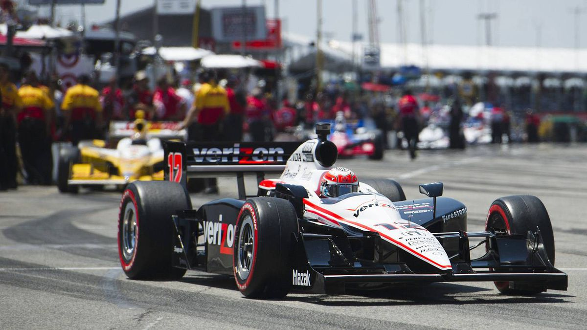 Team Penske driver Will Power of Australia races out of the pit area on his way to a first place to gain pole position during the qualification race at the Honda Indy Toronto, July 9, 2011.